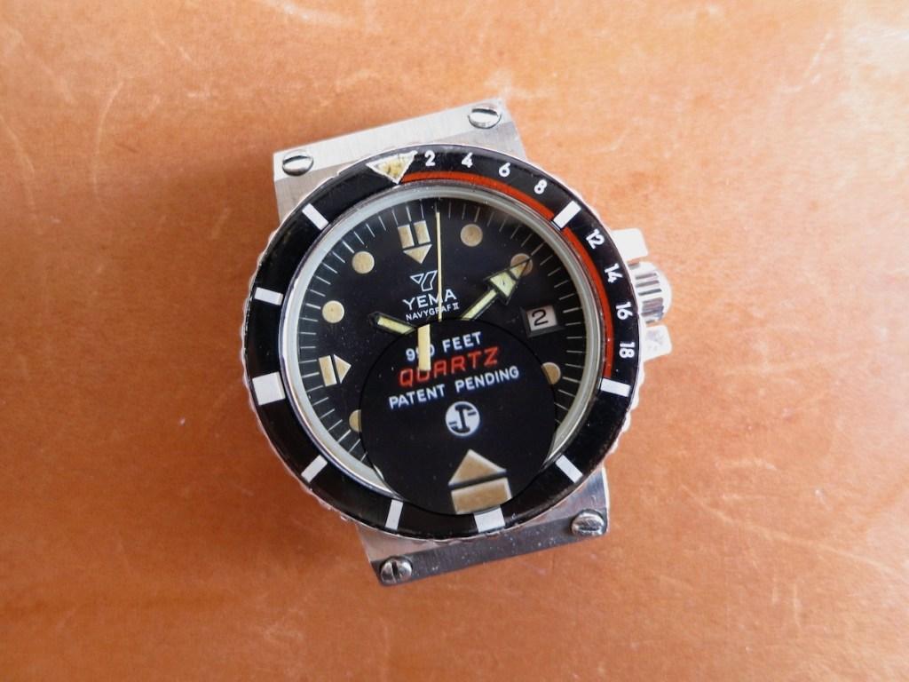 YEMA Navygraf 961 122 | Black dial, circled logo, propeller pictogram, quartz ESA Y2 9362 - credit erry